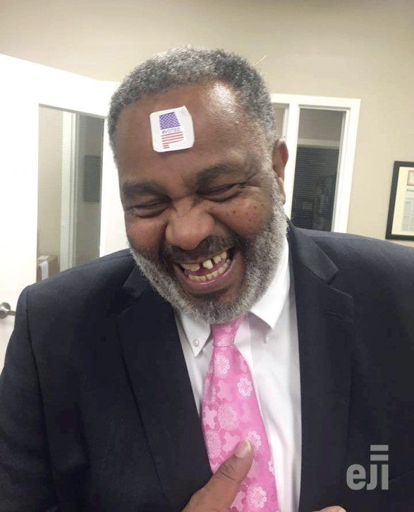In this photo provided by Equal Justice Initiative, former death row inmate Anthony Ray Hinton laughs with a #VOTED sticker on his forehead, on Election Day, Tuesday, Nov. 6, 2018, in Montgomery, Ala. AP