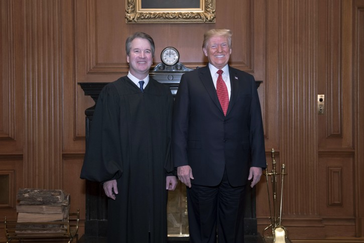 In this image provided by the Supreme Court, President Donald Trump poses for a photo with Associate Justice Brett Kavanaugh in the Justices' Conference Room before a investiture ceremony Thursday, Nov. 8, 2018, at the Supreme Court in Washington. (Fred Schilling/Collection of the Supreme Court of the United States via AP)