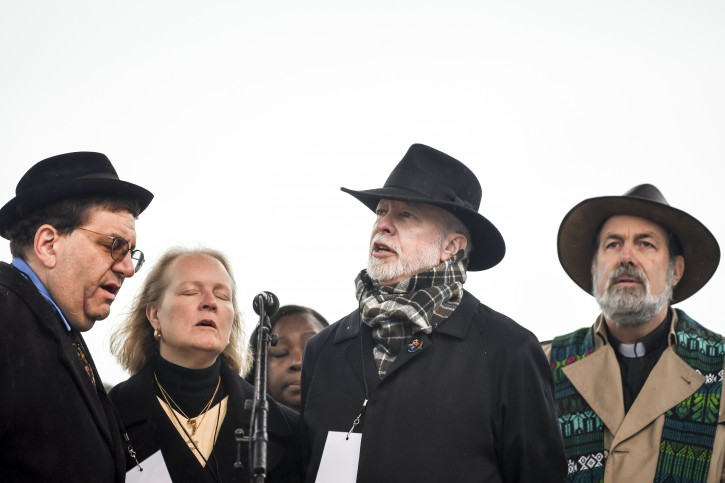 Rabbi Jonathan Perlman, from left, Rabbi Cheryl Klein and Rabbi Jeffrey Myers, along with other clergy including the Rev. David Carver, take the stage to address the crowd during the Rally for Peace and Tree of Life Victims, Friday, Nov. 9, 2018, at Point State Park in downtown Pittsburgh. AP