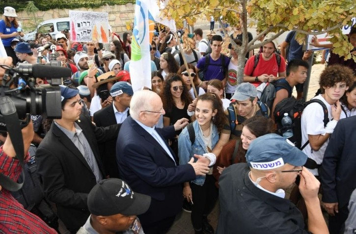 Teens from Gaza border communities meet Israeli President Reuven Rivlin in Jerusalem at the end of their 100-mile walk from Sderot in southern Israel. (Haim Zach/GPO)
