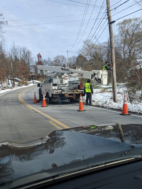 Workers in Highland Mills are seen attaching PVC pipes to utility poles to serve as an Eruv. (cortesy)