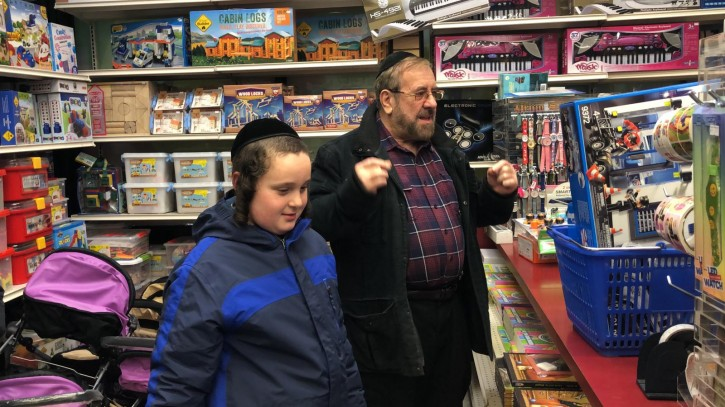 Manny Krausz is seen at the Toy Store with the Hasidic boy who was knocked down by teens on the streets of Williamsburg in an unprovoked attacks
