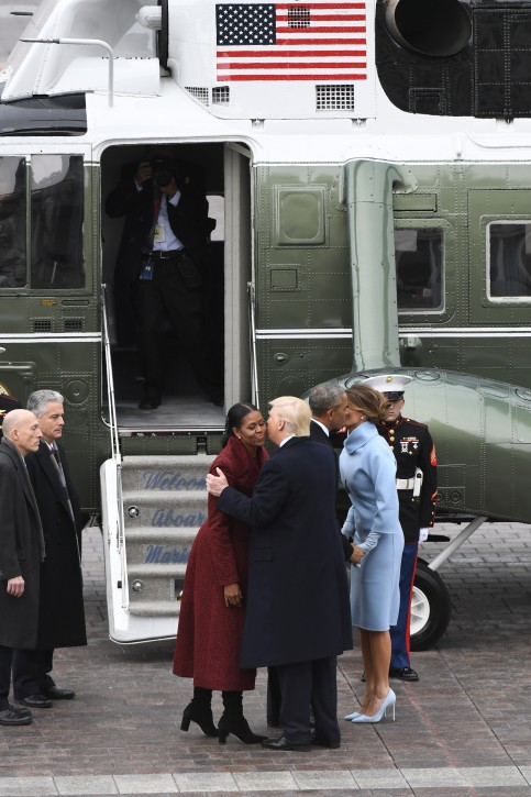 FILE -  Former US president Barack Obama (2-R) and Michelle Obama (L) bid farewll to President Donald Trump (2-L) and Melania Trump (R), in front of Marine One on the East front as Obama departs from the 2017 Presidential Inauguration at the US Capitol, in Washington, DC, USA, 20 January 2017. EPA