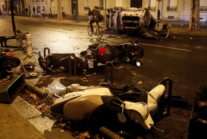 Damaged vehicles are seen on avenue Kleber after clashes with protesters wearing yellow vests, a symbol of a French drivers' protest against higher diesel taxes, in Paris, France, December 1, 2018.  REUTERS/Charles Platiau