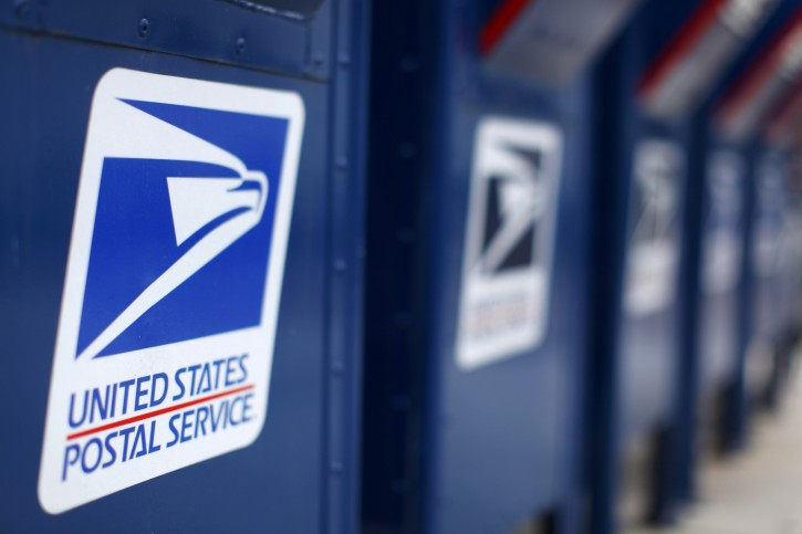 FILE - A view shows U.S. postal service mail boxes at a post office in Encinitas, California in this February 6, 2013, file photo. REUTERS/Mike Blake/Files