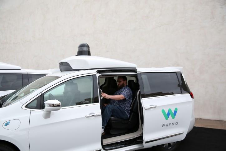 FILE - Early rider Alex Hoffman seen inside a Waymo self-driving vehicle, during a demonstration in Chandler, Arizona, November 29, 2018. REUTERS/Caitlin