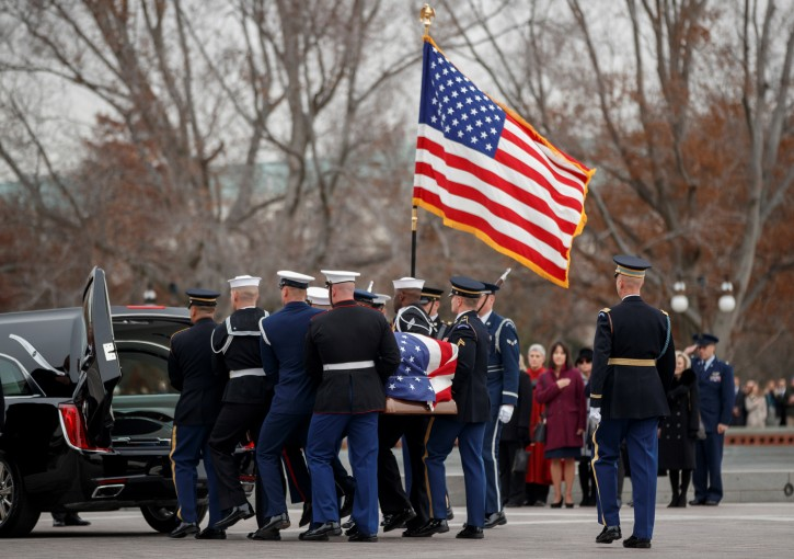 A joint service honor guard carries the casket of former US President George H.W. Bush out of the US Capitol in Washington, DC, USA, 05 December 2018. Shawn Thew/Pool via REUTERS