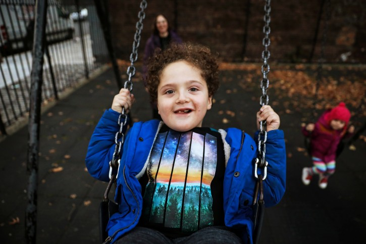 Natan is pushed on a swing by his mother, Reuters' U.S. Health Editor Michele Gershberg, in a park in Brooklyn, New York City, U.S., November 19, 2018. Picture taken November 19, 2018. REUTERS/Brendan McDermid