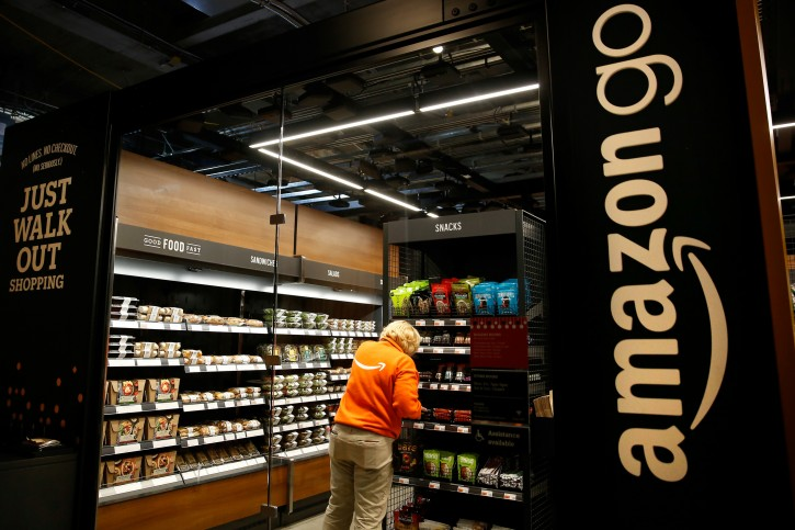 Amazon associate Cindy Umipig checks inventory at a smaller format Amazon Go store, which will be open to Amazon employees and their guests, in the Blue Shift office in downtown Seattle, Washington, U.S., December 10, 2018. REUTERS/Lindsey Wasson