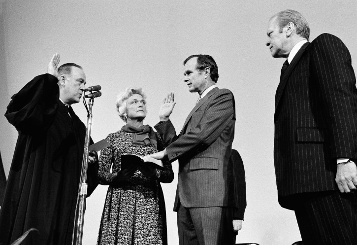 ** FILE ** George H.W. Bush, center, is sworn in as director of the Central Intelligence Agency by Supreme Court Associate Justice Potter Stewart, left, as Barbara Bush and President Gerald Ford, right, look on at CIA headquarters in Langley, Va., in this January 30, 1976, file photo.  Bush succeeds William Colby who retired. (AP Photo, file)