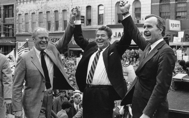 ** FILE ** Former President Gerald Ford lends his support to Republican presidential candidate Ronald Reagan and his running mate George H.W. Bush, in Peoria, Ill., in this Nov. 3, 1980, file photo. (AP Photo, file)