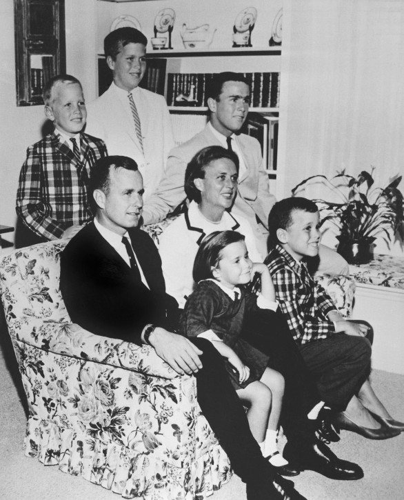 FILE - In this 1964 file photo, George H.W. Bush sits on couch with his wife Barbara and their children. George W. Bush sits at right behind his mother. Behind couch are Neil and Jeb Bush. Sitting with parents are Dorothy and Marvin Bush. AP