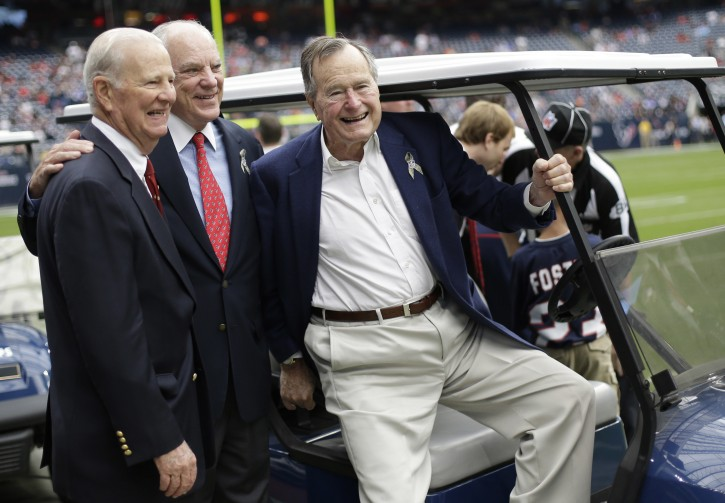 FILE - In this Nov. 4, 2012 file photo, former President George H. W. Bush, right, former Secretary of State James Baker, left, and Houston Texans owner Bob McNair pose together before an NFL football game against the Buffalo Bills in Houston. AP