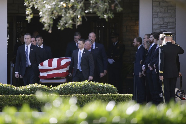 Members of the U.S. Secret Service carry the casket to the hearse at George H. Lewis Funeral Home during a departure ceremony for a state funeral for former President George H.W. Bush, Monday, Dec. 3, 2018, in Houston.  Monday, Dec. 3, 2018, in Houston. (AP Photo/Kiichiro Sato)
