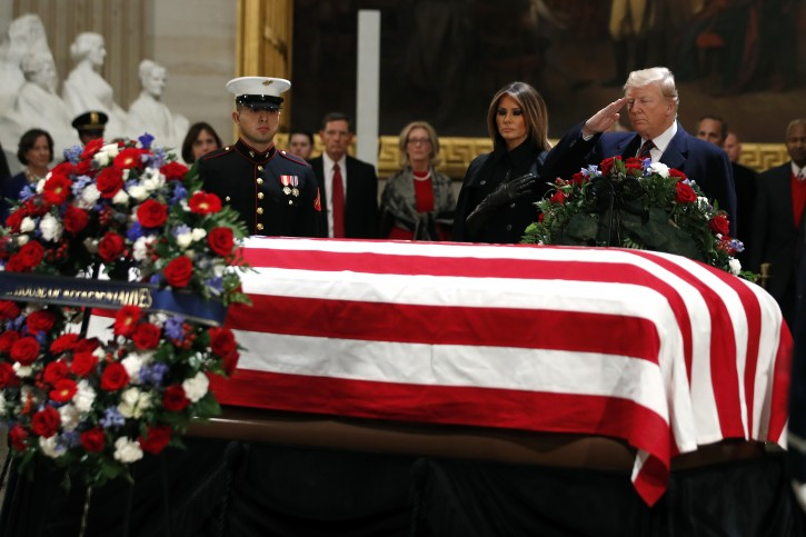 President Donald Trump and first lady Melania Trump pay their respects to former President George H. W. Bush, as he lies in state in the Rotunda of the U.S. Capitol, Monday, Dec. 3, 2018, in Washington. (AP Photo/Jacquelyn Martin)