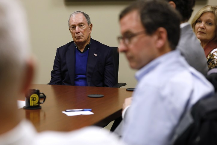 Former New York Mayor Michael Bloomberg, center, participates in a roundtable discussion at the Paulson Electric Company, Tuesday, Dec. 4, 2018, in Cedar Rapids, Iowa. (AP Photo/Charlie Neibergall)