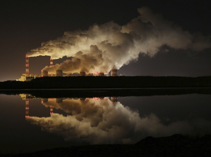 FILE - In this Wednesday, Nov. 28, 2018 file photo, plumes of smoke rise from Europe's largest lignite power plant in Belchatow, central Poland. After several years of little growth, global emissions of heat-trapping carbon dioxide surged in 2018 with the largest jump in seven years, discouraged scientists announced Wednesday, Dec. 5, 2018. (AP Photo/Czarek Sokolowski)