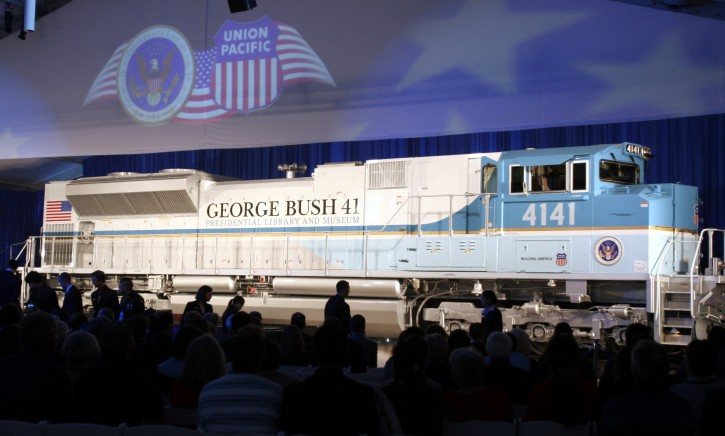 FILE - In this Oct. 18, 2005, file photo, a new locomotive numbered 4141 in honor of the 41st president, George H.W. Bush, is unveiled at Texas A&M University in College Station, Texas. The locomotive unveiled for the special exhibit at George H.W. Bush's presidential library will be used to pull the late president's funeral train. The 4,300-horsepower machine will carry Bush's remains Thursday, Dec. 6, 2018, to his final resting place at his presidential library. (AP Photo/Pat Sullivan, File)