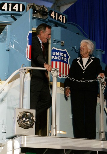 FILE - In this Oct. 18, 2005, file photo, former President George H.W. Bush and his wife, Barbara, tour a new locomotive numbered 4141 in honor of the 41st president at Texas A&M in College Station, Texas.  (AP Photo/Pat Sullivan, File)