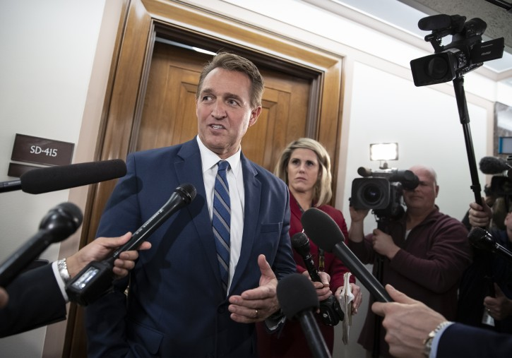 Sen. Jeff Flake, R-Ariz., a member of the Senate Foreign Relations Committee, speaks with reporters as senators are considering multiple pieces of legislation in an effort to formally rebuke Saudi Arabia for the slaying of journalist Jamal Khashoggi, on Capitol Hill in Washington, Thursday, Dec. 6, 2018. (AP Photo/J. Scott Applewhite)