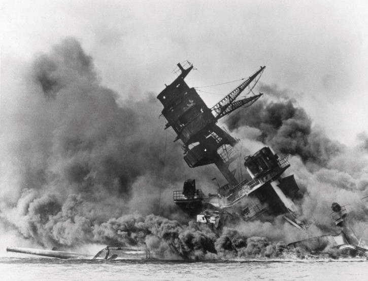 In this Dec. 7, 1941 file photo, smoke rises from the battleship USS Arizona as it sinks during the Japanese attack on Pearl Harbor, Hawaii. About 20 survivors are gathering on Friday, Dec. 7, 2018 at Pearl Harbor to remember thousands of men lost in the Japanese attack 77 years ago. The youngest of the survivors is in his mid-90s. The Navy and National Park Service will jointly host the remembrance ceremony Friday at a grassy site overlooking the water and the USS Arizona Memorial. (AP Photo, File)