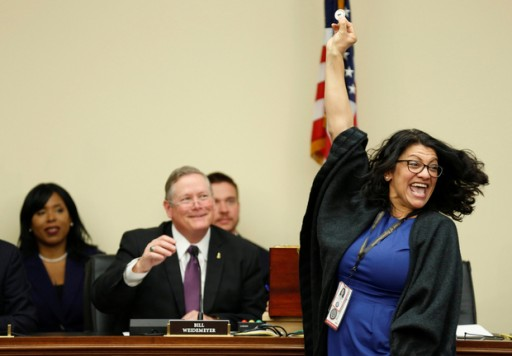 Representative-elect Rashida Tlaib (D-MI) reacts to drawing number 8 during a lottery for office assignments on Capitol Hill in Washington, U.S., November 30, 2018.      REUTERS/Joshua Roberts