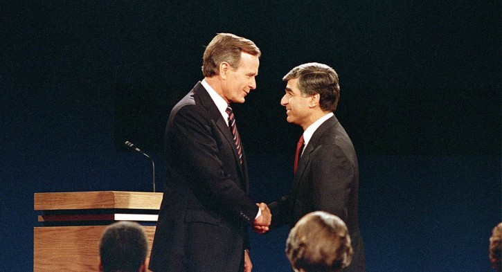 FILE - dukakis and Bush shake hands before their second and final debate at the University of California, Los Angeles on October 13, 1988.  AP Photo/Lennox McLendon