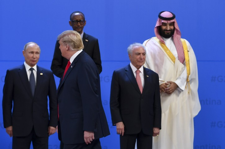 US President Donald Trump (front) walks past Crown Prince of Saudi Arabia Mohammad Bin Salman Al Saud (top right) President of Brazil Michel Temer (right), President of Russia Vladimir Putin ahead of the family picture at the G20 summit in Buenos Aires, Argentina, 30 November 2018. EPA