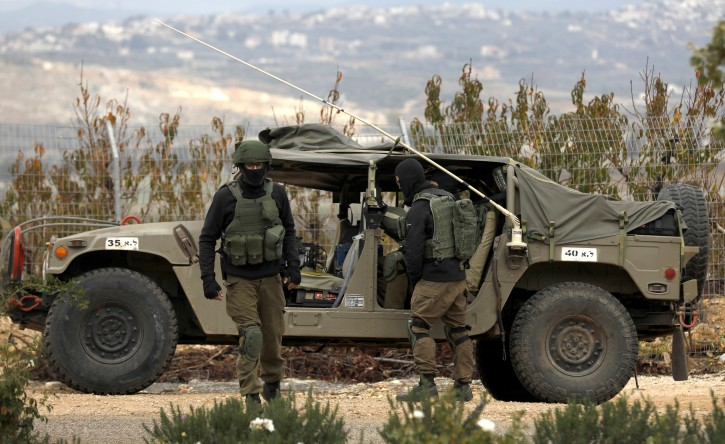 Israeli soldiers patrol on the Israel border with Lebanon, near the northern Israeli town of Metula, 05 December 2018. EPA