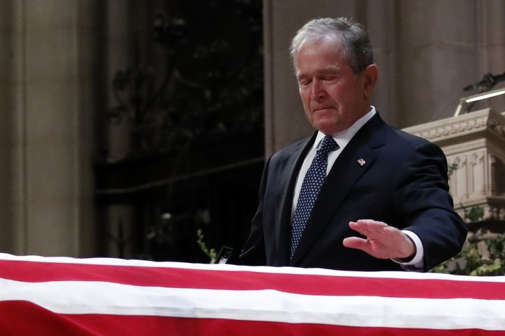 Former US President George W. Bush touches the casket of his father, former US President George H.W. Bush, at the State Funeral at the National Cathedral, in Washington, DC, USA, 05 December 2018. EPA