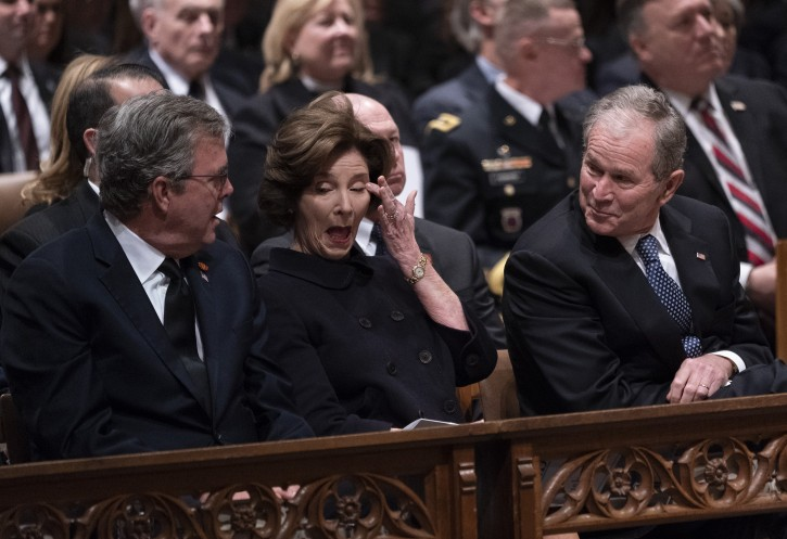 Former First Lady Laura Bush wipes her eye during a moment of levity as Former US President George W. Bush (R) and Former Florida governor Jeb Bush (L) look on during the state funeral service of former President George H.W. Bush at the National Cathedral, in Washington, DC, USA, 05 December 2018.
