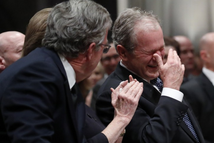 Former US President George W. Bush (R) reacts with his brother Former Florida governor Jeb Bush (L) at the State Funeral for their father, former US President George H.W. Bush, at the National Cathedral, in Washington, DC, USA, 05 December 2018. EPA