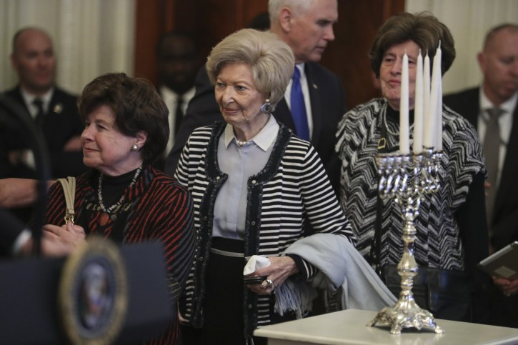 Holocaust survivors walk up the stage as US President Donald J. Trump speaks during a Hanukkah reception in the East Room of the White House in Washington, DC, USA, 06 December 2018.  EPA-EFE/Oliver Contreras / POOL