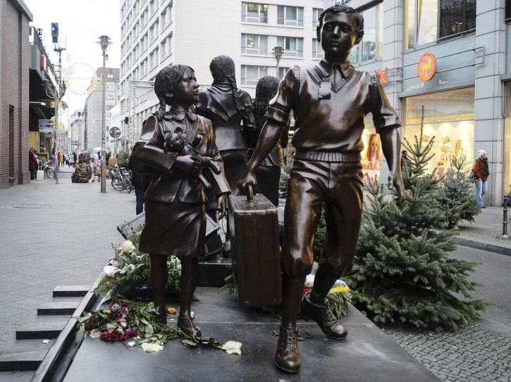 Kindertransport survivors, commemorated by a statue in Berlin, Germany. AP