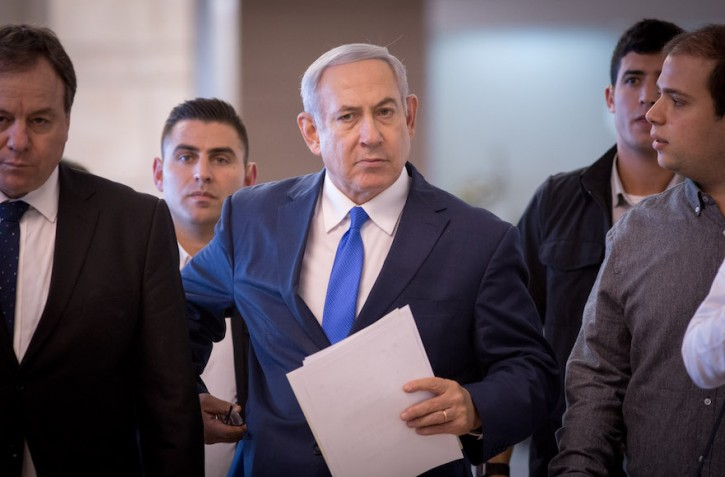 FILE - Israeli prime minister Benjamin Netanyahu arrives to a faction meeting in the Israeli parliament on November 19, 2018. Photo by Miriam Alster/FLASH90