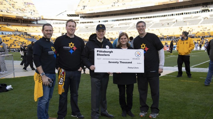 Steelers President Art Rooney II present a check to the Jewish Federation of Greater Pittsburgh's Victims of Terror Fund.