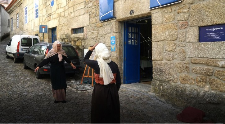 Actors re-enact scenes from the Inquisition period outside Belmonte's Jewish museum, Oct. 14, 2018. (Cnaan Liphshiz)