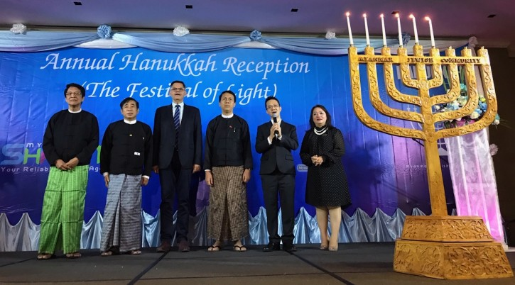 Sammy Samuels, second from right, sings at a Hanukkah event with Burmese leaders. Israel's ambassador to Myanmar, Ronen Gilor, is third from left; between them is Phyo Min Thein, the chief minister of the Yangon region. (Charles Dunst)