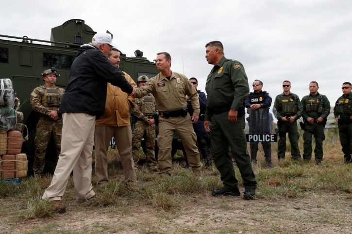 President Donald Trump shakes hands with U.S. Border Patrol Air and Marine Operations Director Don Sperling as he visits the banks of the Rio Grande River with Senator Ted Cruz (R-TX) during the president's visit to the U.S. - Mexico border in Mission, Texas, U.S., January 10, 2019. REUTERS/Leah Millis
