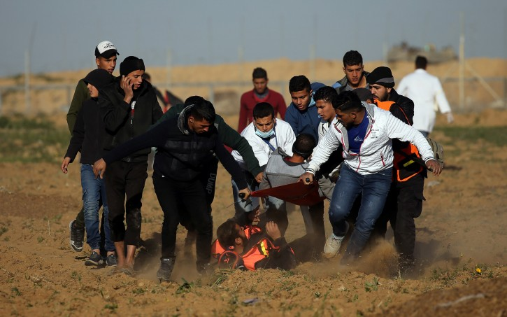 A wounded Palestinian demonstrator is evacuated during a protest at the Israel-Gaza border fence, in the southern Gaza Strip January 11, 2019. REUTERS/Ibraheem Abu Mustafa