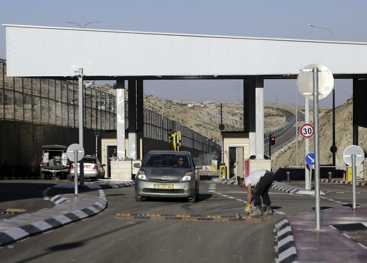 """A checkpoint is seen at the newly opened segregated West Bank highway near Jerusalem Thursday, Jen. 10, 2019. Israel has opened a controversial new West Bank highway on Thursday that features a large concrete wall segregating Israeli and Palestinian traffic. Critics have branded the road an """"apartheid"""" highway, saying it is part of a planned segregated road system that would benefit Israelis exclusively. (AP Photo/Mahmoud Illean)"""