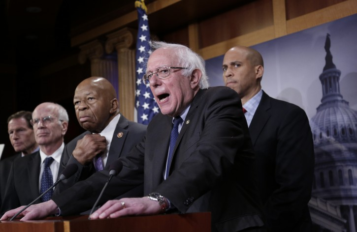 "Sen. Bernie Sanders, I-Vt., center, joined from left by S en. Richard Blumenthal, D-Conn., Rep. Peter Welch, D-Vt., Rep. Elijah Cummings, D-Md., and Sen. Cory Booker, D-N.J., speaks to reporters as he prepares to introduce new legislation that aims to reduce what Americans pay for prescription drugs, especially  brand-name drugs deemed ""excessively priced,"" during a news conference on Capitol Hill in Washington, Thursday, Jan. 10, 2019. (AP Photo/J. Scott Applewhite)"