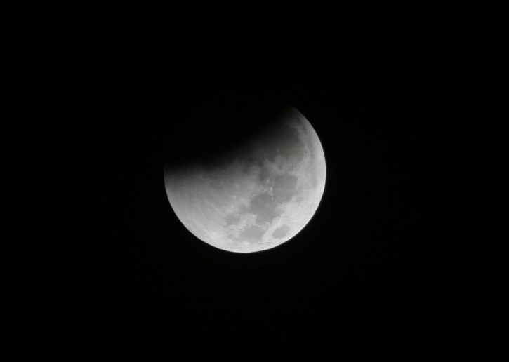 The moon is seen during a complete lunar eclipse over Saturday Aug. 28, 2018 in Jakarta, Indonesia. Skywatchers around much of the world are looking forward to a complete lunar eclipse that will be the longest this century. (AP Photo/Tatan Syuflana)
