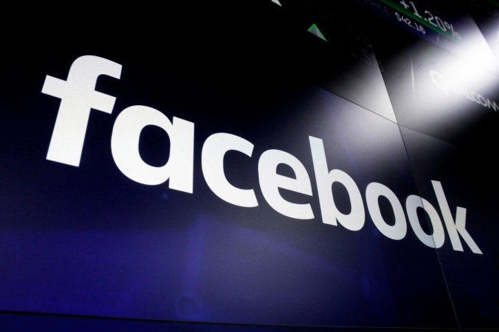 FILE - In this March 29, 2018, file photo the logo for Facebook appears on screens at the Nasdaq MarketSite, in New York's Times Square. (AP Photo/Richard Drew, File)