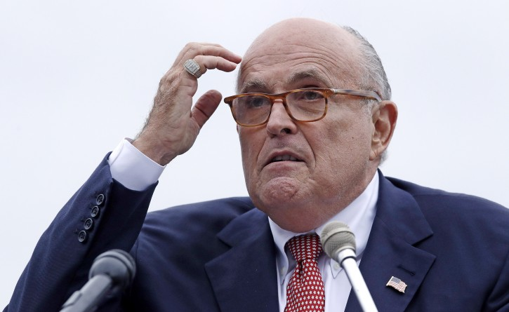 FILE - In this Aug. 1, 2018 file photo, Rudy Giuliani, an attorney for President Donald Trump, addresses a gathering during a campaign event for Eddie Edwards, who is running for the U.S. Congress, in Portsmouth, N.H. (AP Photo/Charles Krupa, File )