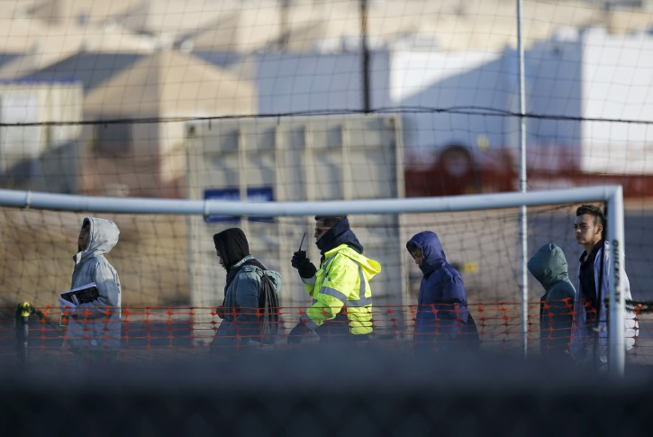 Teen migrants walk in line inside the Tornillo detention camp in Tornillo, Texas, Thursday Dec. 13, 2018. The Trump administration announced in June 2018 that it would open the temporary shelter for up to 360 migrant children in this isolated corner of the Texas desert. (AP Photo/Andres Leighton)