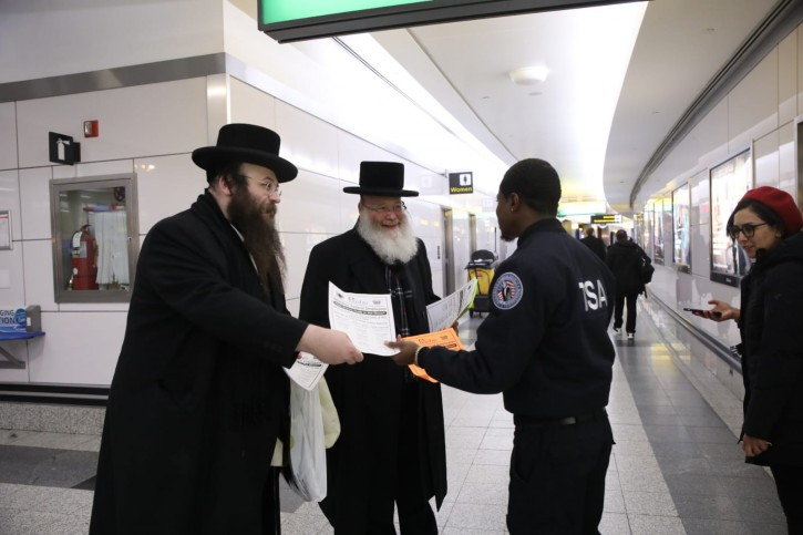 Brooklyn resident Alex Rappaport Founder and CEO of the Jewish soup Kitchen Masbia, handing out flyers at LaGuardia Airport, informing Federal workers who's pay check have been affected by the U.S. Government shutdown, about free grocery's and food for their family by his organization.