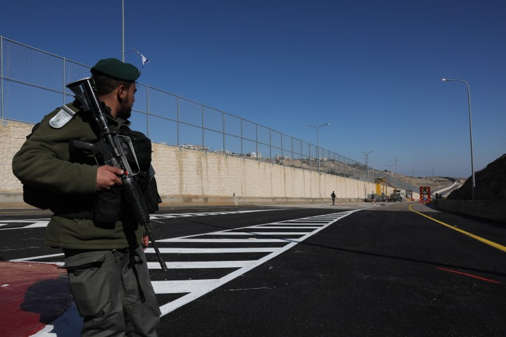 Israeli border Policemen stand on the Israeli side of the road that separates between Israelis and Palestinians near the Issawiya neighborhood and Shuafat refugee camp in East Jerusalem, 10 January 2019. EPA