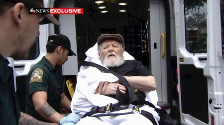 FILE - Jakiw Palij is carried on a stretcher from his home in Jackson Heights, Queens, on Monday. Justice Department officials said Palij worked at a concentration camp in German-occupied Poland. Photo Credit: ABC via AP