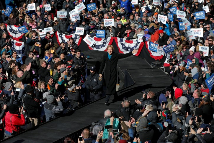 U.S. Senator Elizabeth Warren (D-MA) takes the stage at a rally to launch her campaign for the 2020 Democratic presidential nomination in Lawrence, Massachusetts, U.S., February 9, 2019.   REUTERS/Brian Snyder